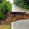 Tribune-Star file photo/Jim Avelis<br /> Do not cross: A creek washed out a section of Woodsmall Road overnight Friday, June 6, 2008. A 15-foot-wide gap was made by the flash flood waters.