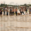 Tribune-Star file photo/Jim Avelis<br /> Assembly line: Volunteers spread across US 40 on the west side of West Terre Haute to build a bank of sandbags to stem the flow of Sugar Creek flood waters Saturday, June 7, 2008.