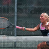 Within reach: Terre Haute South's Taylor Bullock finds a volley within her reach as she plays Munster's Bobbi Modesto in their No. 2 singles match Saturday in the state tennis tournament at North Central High School.