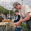 Onion for sale: Aaron Warner and his son, Journey Warner, 9, clean onions they have for sale at the family's Farmer's Market stand Saturday downtown.