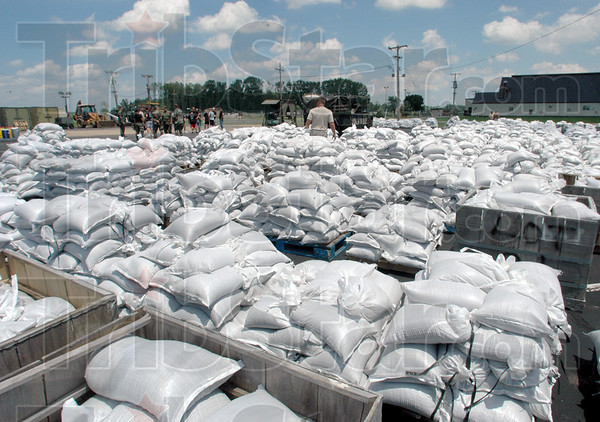 Tribune-Star file photo/Bob Poynter<br /> Sandbags: Approximately 12,000 sand bags were filled at Hulman Field Sunday, June 8, 2008 by military personnel and inmates from the Wabash Valley Correctional Facility.