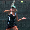 Forehand return: Terre Haute South's Hunter Bullock returns a forehand to Munster's Mary Hill during their No. 1 singles match Saturday in the ststae tennis tournament in Indianapolis.