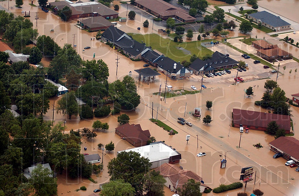 Tribune-Star file photo/Jim Avelis<br /> Widespread: The intersection of 7th Street at Springhill Drive lays beneath floodwaters Saturday, June 7, 2008. Anywhere from 7 to 11 inches of rain fell in different areas of the Valley from Friday evening to Saturday morning.