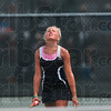 A grinder of a tennis match: Terre Haute South's Taylor Bullock reacts to hitting the ball into the net during close no. 2 singles match against Munster's Bobbi Modesto Saturday during the state tennis tournament at North Central High School in Indianapolis.