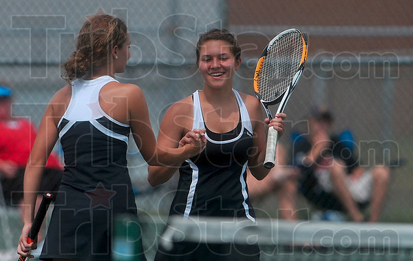 We did it: Terre Haute South's Mallory Metheny and Emmy Bilyeu celebrate their No. 1 doubles victory against Munster Saturday during the tennis state championship tournament at North Central High School in Indianapolis.