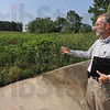 Tribune-Star file photo/Joseph C. Garza<br /> Taking the necessary steps: Dave Rader, the director of environmental health and safety at the Terre Haute Pfizer plant, discusses Wednesday, Aug. 27, 2008 the steps the company has taken to fix the damage caused by the June 7, 2008 floods that also damaged a retention pond (behind Rader) on the company's property.