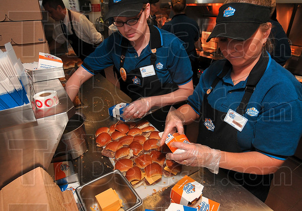 Tribune-Star/Joseph C. Garza<br /> Made to order: White Castle employees Tina Williams and Tammy Smith rapidly prepare a customer's order as they work in the drive-thru area of the new hamburger restaurant Tuesday.