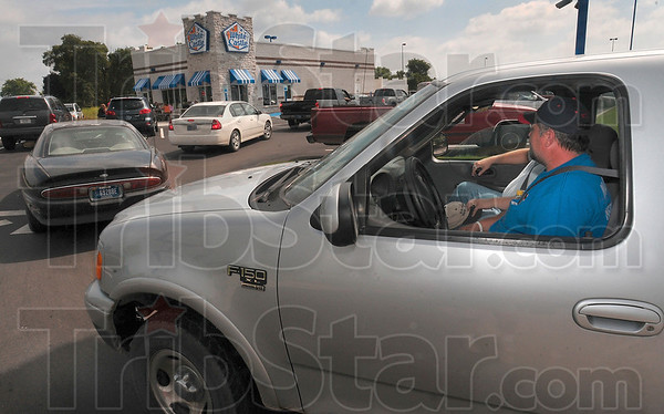 Tribune-Star/Joseph C. Garza<br /> A year too long: White Castle customer Jeff Orndorff of West Terre Haute waits in the drive-thru line Tuesday at the new White Castle on US 41 in front of Sam's Club. Orndorff said it has been about a year since he had a White Castle hamburger.