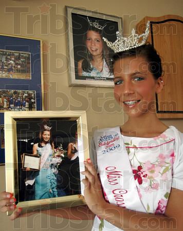 Winner: Kelsey Gottardi holds a photograph from her win as Miss Crossroads.