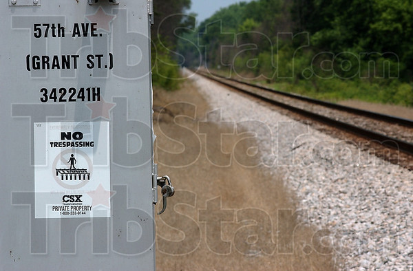 """Cleary posted: """"No Trespassing"""" signs adorn an electrical box belonging to CSX railway along Grant St. noth of North Terre Haute. The site is about a quarter mile from the railroad trestle where Mark Priehs and his son Braden were injured Tuesday evening."""