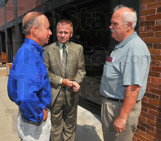 Meet and greet: Governor Mitch Daniels chats with Rod Henry of the Convention and Visitors Bureau and new Vigo County commissioner Mike Ciolli. Daniels was in Terre Haute Wednesday to talk about the State budget.