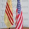 Allies: Joseph Vu keeps a South Vietnamese flag next to an American flag in his livingroom.