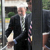 Enter: David Decker and his attorney William Smock enter the Federal Courthouse Wednesday afternoon for a hearing.