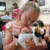 Autograph: Heidi Mattick writes on a stuffed animal at Rio Grande Elementary School Wednesday morning.