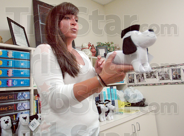 Autograph dog: Jenna Lydick gives students a stuffed dog for collecting autographs at Rio Grande Elementary School Wednesday morning.
