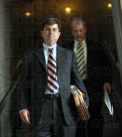 Emerging from the darkness: Terre Haute Attorney William Smock and David Decker emerge from a dark stairwell in the Federal Courthouse after a hearing Wednesday afternoon.