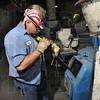 Tribune-Star/Joseph C. Garza<br /> Energy production: Duke Energy Production Team member Shane Summers rods the coal feeder at the Wabash River generating station Monday.