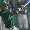 Tribune-Star/Joseph C. Garza<br /> Over the wildcats: West Vigo's Jordan Pearson watches the ball fly over the South Vermillion infield during the Vikings' sectional championship win Monday at West Vigo.