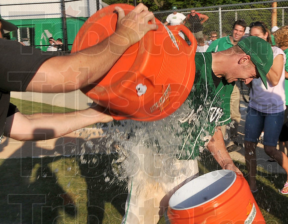 Tribune-Star/Joseph C. Garza<br /> ...that athletic trainer Greg McDonald was ready for Welch and his teammate with a half-full cooler himself Monday after the baseball sectional championship at West Vigo High School.
