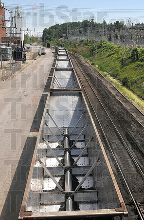 Tribune-Star/Joseph C. Garza<br /> A demanding load: Empty coal rail cars sit outside the Duke Energy Wabash River Generating Station in West Terre Haute Monday. According to plant general manager, Frank Klopfstein, the plant uses about 60 to 70 cars of coal a day during the summer.