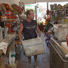 Making the rounds: Joe Coad carries the daily mail from Cecil Tilford's Variety store Monday afternoon.  After a brief shutdown, Tilford's Variety Store in 12 Points is once again a U.S. Postal service center.