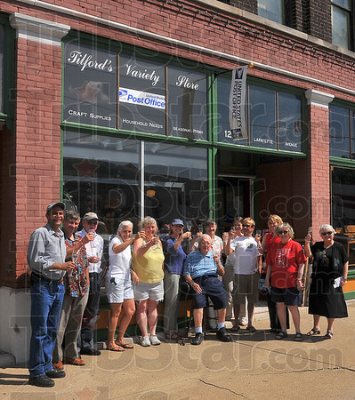 Cheers:A group of 12 Points regulars helps celebrate the reopening of the U.S. Postal Service in Cecil Tilford's variety store on Lafayette Avnue.