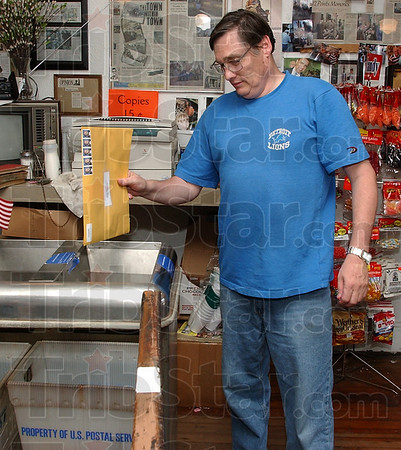 At your service: Regular customer Dean Waggoner drops mail into the box at Tilford's Variety Store Monday afternoon. Waggoner said he uses the conveniet service every day of two.