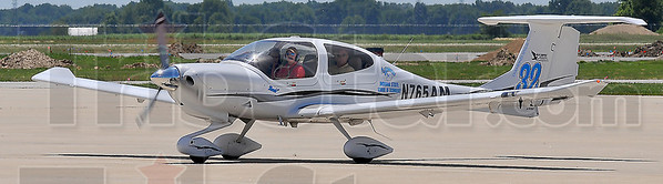 Home again: Jessica Campbell brings the Diamond DA40 aircraft into a parking spot at Hulman Field Monday afternoon. She and Virginia Dunbar placed second overall and first among collegiate entries in the 2,359 mile Air Race Classic this past week. With them is Tad Foster of ISUs school of Technology, their sponsor in the event.