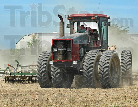 Finishing: Mike Pruitt uses a finishing tool as he prepares a field for planting of corn Tuesday afternoon in the Industrial Park.