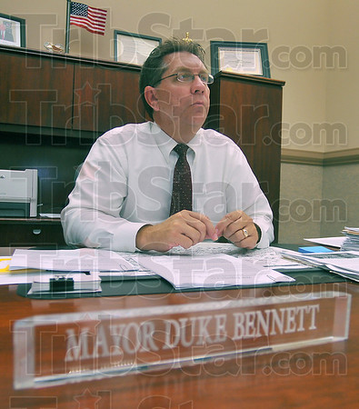 It's official: Terre Haute mayor Duke Bennett sits at his desk mid-afternoon Tuesday. The Indiana Supreme Court upheld a lower cout decision that  meant Bennett would keep the office.