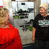 Good times: Friends Trish Schoffstall and Kim Dyer chat about the West Vigo baseball team in Schoffstall's store Tuesday afternoon. Dyer, a Viking Cheerleader in the '70s, follows the baseball team closely.