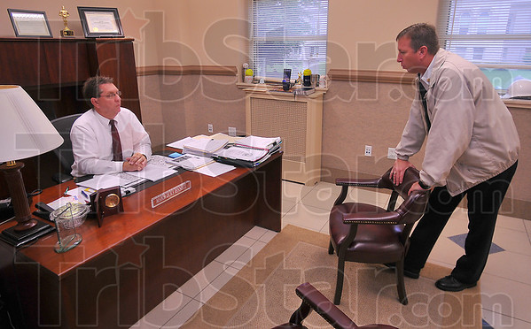 Back to business: Terre Haute Mayor Duke Bennett talks business with his Fire Chief Jeff Fischer Tuesday afternoon. After a flurry of visitors shortly after the Indiana Supreme Court announced it's decision, the mayor's office returned to normal.