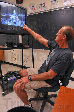 Inspiration: West Vigo head baseball coach Steve DeGroote reviews a video tape of Pete Gray, a one-armed professional baseball player from the 1940s. DeGroote used the clip during a team meting Tuesday afternoon.