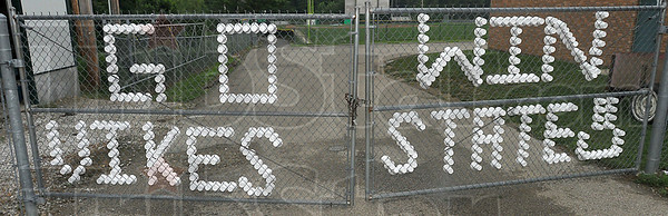 Spell it out: Styrofoam cups in a chain link fence make a message for the West Vigo Baseball team Tuesday. The Vikings will make their schools' first appearance ever in the finals of the state baseball tourney Saturday.