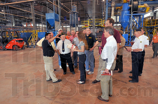 On tour: Ziggy Pablo leads a tour group through the new Brampton Brick plant Tuesday during an open house.