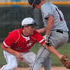Safe, but not from the rain: Terre Haute North's Parker Fulkerson beats the tag by Terre Haute South's Richard Wheatfill at second base during the teams' sectional game that was interrupted by rain Tuesday at Martinsville.