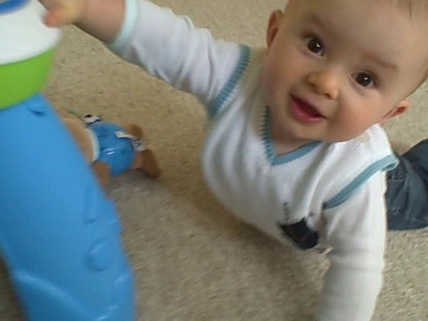 Max crawling with his little frog kick!