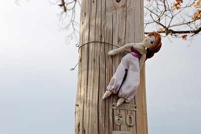 Voodoo Barbie is still in place on the utility pole.  She is in one of the other galleries from last summer.  I say she's guarding the field with the boulder... or not.