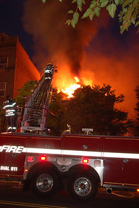 XXXXX Bergen; Leonia 7/27/2009  Several towns responded to a 3 alarm fire at 174  Ft. Lee Rd Monday in large two and half story building next door to large apartment complex. BILL TOMPKINS/FREELANCE
