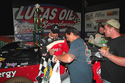 Earl Pearson, Jr. signs an autograph in Victory Lane @ Lucas Oil Speedway