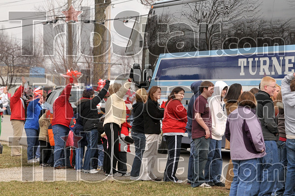Tribune-Star/Joseph C. Garza<br /> Next stop: Peoria: Well-wishers wave as the bus carrying the Marshall, Ill., High School boys basketball team passes by on north Sixth Street Thursday near the high school in Marshall.