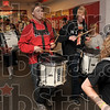 Tribune-Star/Joseph C. Garza<br /> A final four beat: Members of the Marshall High School drum line begin a procession through the hallway of the school Thursday with the members of the boys basketball team following behind them.