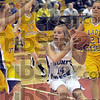 Surrounded: Honey Creek's #14, Emily Cottom drives the ball into the lane and is immediately surrounded by several Otter Creek defenders including #30, Sierra Sykes, #33, Layne Curley and #21, Madison Hayes during the girl's seventh grade championship game Thursday night.