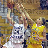 Drive: Honey Creek's #24, Kylie Fendrick drives the ball to the basket during game action Thursday night. Defending for Otter Creek is #21 Madison Hayes.