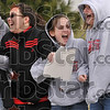 Tribune-Star/Joseph C. Garza<br /> Lions' roar: Marshall, Ill., students cheer as the bus taking the boys basketball team to Peoria approaches on North Sixth Street Thursday in Marshall.
