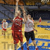 Tribune-Star/Joseph C. Garza<br /> One step ahead: Marshall's Lucas Eitel shoots a lay-up just pass defending teammate Tyler Bishop during team practice Monday in Hulman Center.