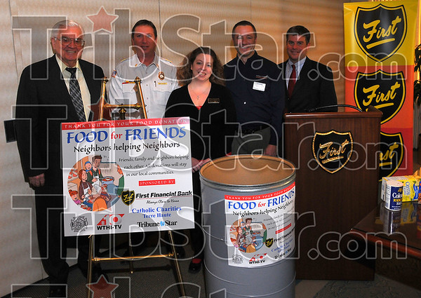 "Good friends: Participants in the new ""Food for Friends"" campaign include: First Financial Bank, represented by Don Smith, The Terre Haute Fire Department (Jeff Fisher), The Terre Haute Tribune-Star(Jennifer Seddelmeyer), Catholic Charities (John Etling) and WTHI(Todd Weber."