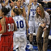 Tribune-Star/Joseph C. Garza<br /> Senior celebration: Members of the Indiana State women's basketball team come off the bench to celebrate a three-point basket by teammate Leah Phillips (10) during the Sycamores' 62-58 win over Bradley Sunday at Hulman Center.