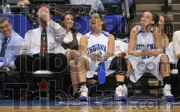 Tribune-Star/Joseph C. Garza<br /> No more 6 a.m. weights: Indiana State women's basketball team coach Jim Wiedie laughs with seniors Leah Phillips and Kara Schilli as they and the audience watch a farewell video of the seniors Sunday at Hulman Center.