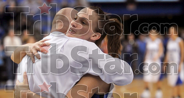 Tribune-Star/Joseph C. Garza<br /> The final walk off: Indiana State's Kara Schilli receives a hug from head coach Jim Wiedie as she leaves her last regular season game in Hulman Center Sunday.
